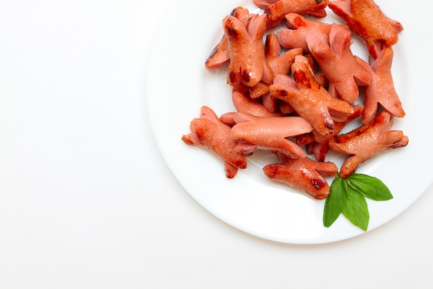 Saucisse grillée au basilic