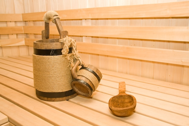 Sauna. seau, tasse et louche