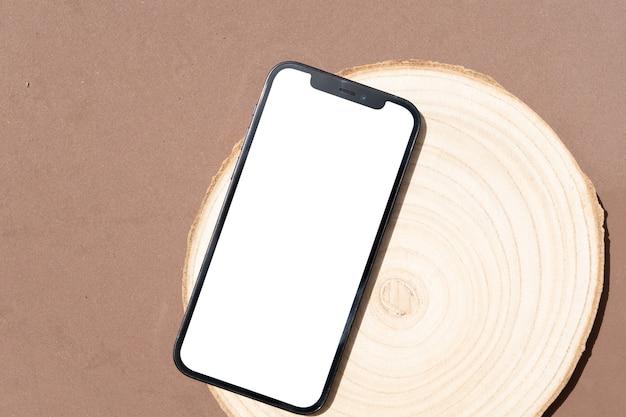 Scène de stock de style herbe sèche dans des tons de terre brune avec une maquette de téléphone moderne