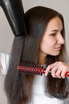Séchage des cheveux féminins