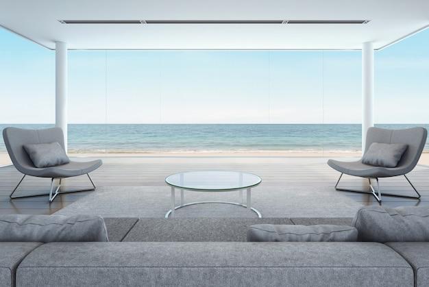 Séjour dans maison de plage, intérieur moderne avec vue mer.