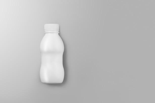 Série de maquettes d'emballage de boissons. petite bouteille en plastique blanche avec reflets et ombres sur fond gris studio. vue de dessus. modèle prêt à être utilisé dans votre conception.
