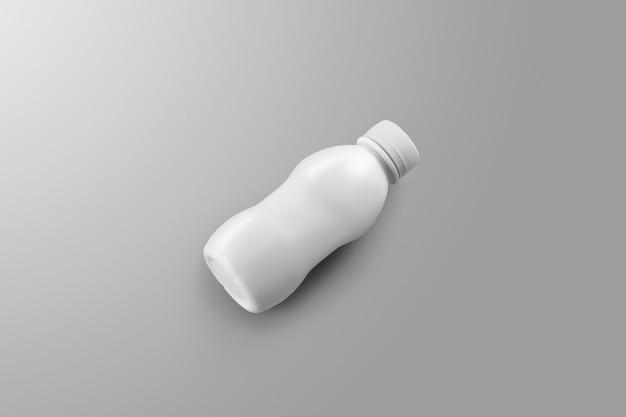 Série de maquettes d'emballage de boissons. une petite bouteille en plastique vierge avec des reflets et des ombres se trouve sur un fond de studio gris. modèle prêt à être utilisé dans votre conception.