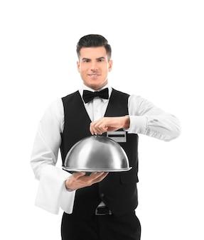 Serveur avec plateau en métal et cloche sur blanc