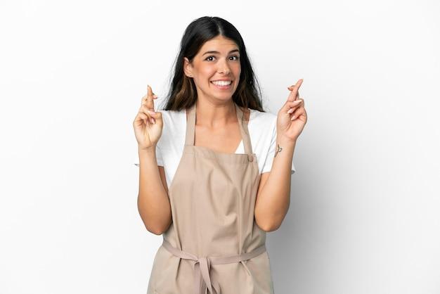 Serveur de restaurant sur fond blanc isolé avec croisement de doigts