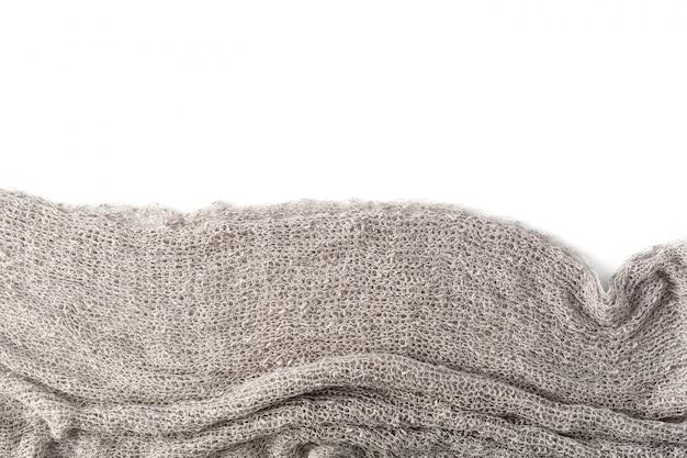 Serviettes grises sur fond blanc