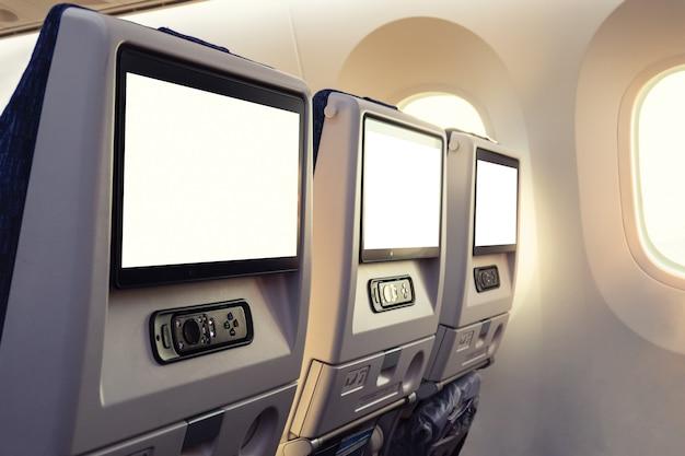 Siège d'avion à l'arrière de la rangée avec affichage vide et joystick par fenêtre