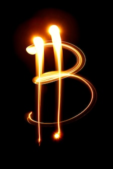 Signe bitcoin sur fond noir. peinture claire