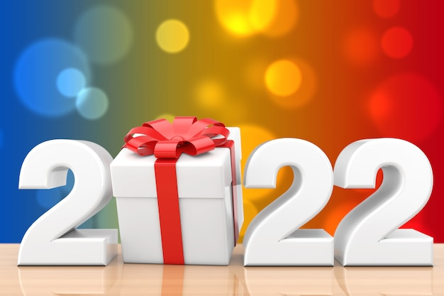 Signe du nouvel an 2022 avec boîte-cadeau et ruban rouge sur une table en bois. rendu 3d
