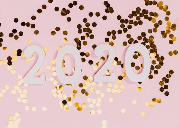 Signe du nouvel an avec des confettis dorés