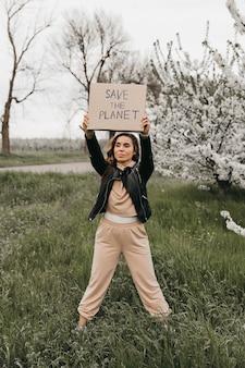 Signe écologique de protestation pour l'avenir vert de la planète lutte contre le changement climatique