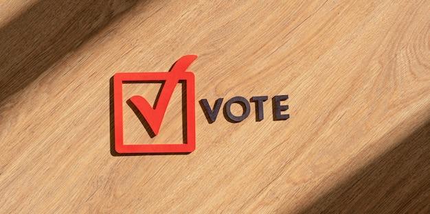 Le signe de vote abstrait de la case à cocher, le cadre et les lettres d'icônes créatives, le concept de démocratie