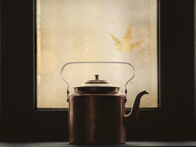 Silhouette d'une bouilloire sur la fenêtre sur fond d'automne