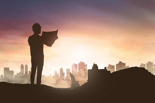 Silhouette d'un homme ingénieur à la recherche de son plan de chantier