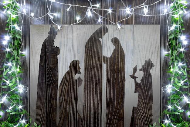 Silhouette de la nativité avec des lumières autour