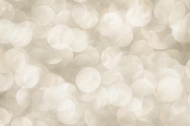 Silver sparkling lights fond festif avec texture.