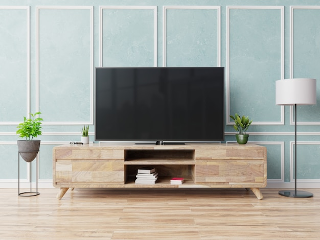 Smart tv sur l'armoire dans le salon moderne sur fond de mur bleu