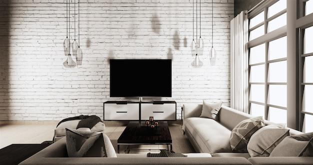 Smart tv sur meuble dans le salon avec mur de briques blanches sur plancher en bois et canapé
