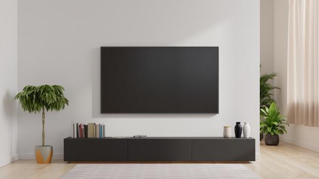 Smart tv sur le mur blanc du salon, design minimaliste.