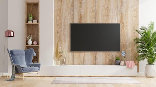 Smart tv sur le mur en bois dans le salon avec fauteuil, design minimaliste