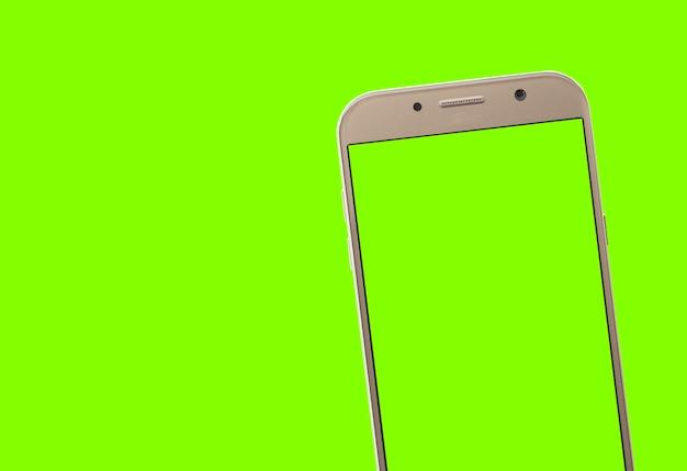 Smartphone avec écran vert et arrière-plan pour le recadrage