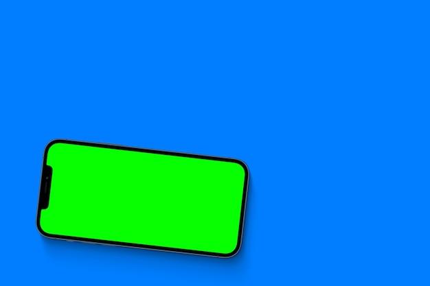 Smartphone avec écran vert. clé chroma. isolé sur fond bleu.