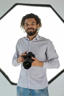 Smiley man holding camera