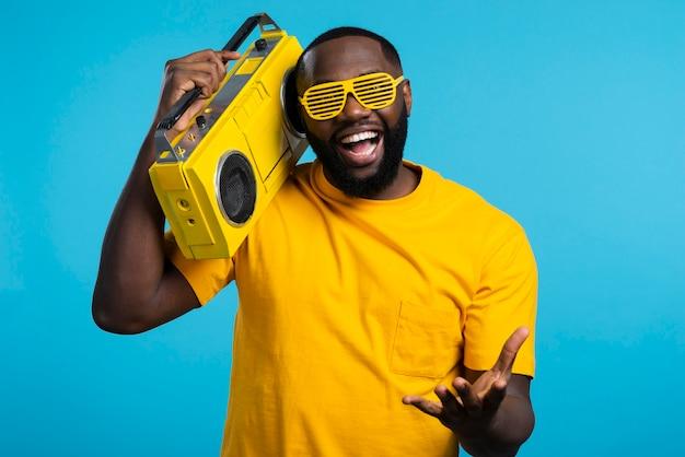 Smiley man holding cassette