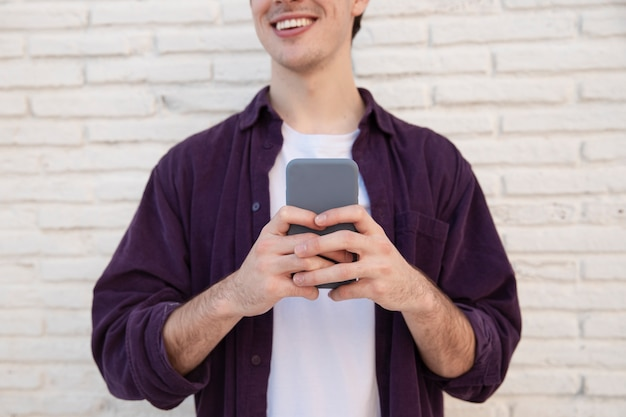 Smiley man holding smartphone