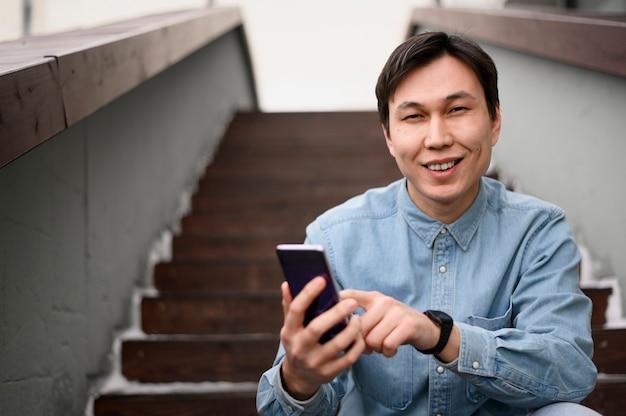 Smiley man using mobile