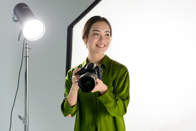 Smiley woman holding camera