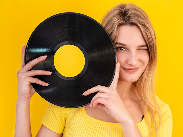 Smiley woman holding vinyl