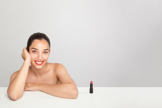 Smiley woman, lipstick and copy space