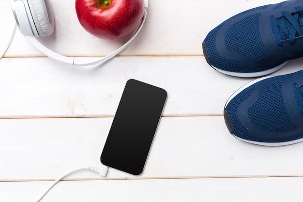 Sneakers et téléphone portable avec casque