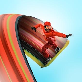 Snowboarder caucasien professionnel en mouvement isolé sur fond bleu studio. fit le saut et le vol sportif en action, jeu, excitation au jeu. conception abstraite, concept de mouvement.