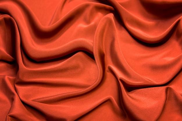 Soie orange foncé lisse et élégante à utiliser.