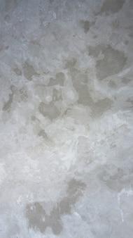 Sol en béton de ciment et ancienne surface de texture rugueuse et couleur grise.