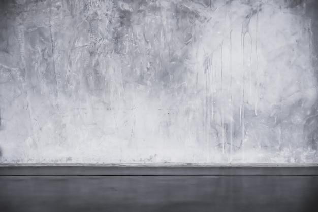 Sol en ciment et arrière-plans muraux, pièce sombre, intérieur.