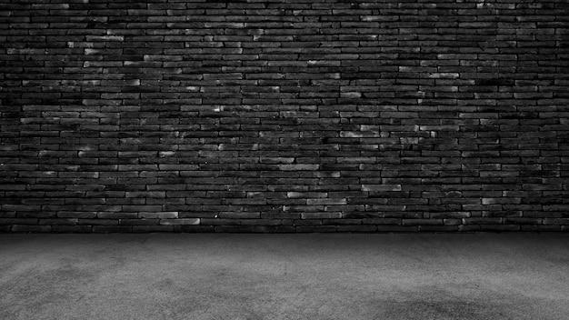Sol en ciment noir et fond de mur, obscurité