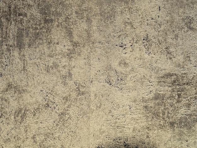 Sol grunge sale et sec fissuré sur la texture de la surface du béton