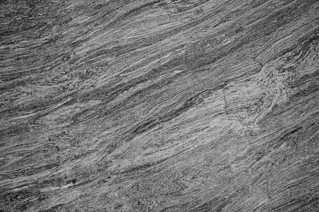 Le sol en pierre noire ou la texture de la pierre peuvent être utilisés comme arrière-plan