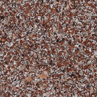 Sol en terrazzo, surface en marbre, texture homogène.