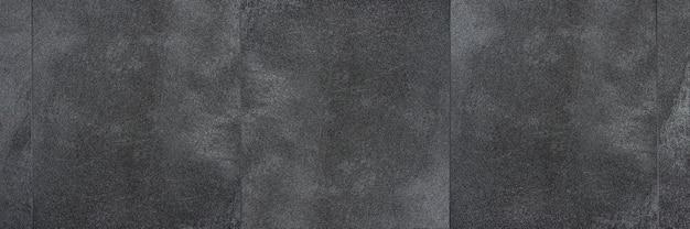 Sol en vinyle pvc la texture du sol en vinyle est des échantillons noirs de vinyle couvrant des carreaux de pvc noirs sur...