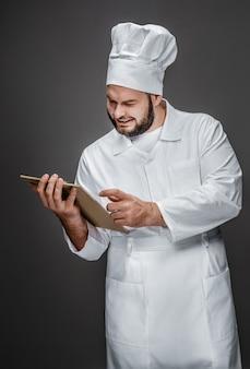 Sourire, cuisinier, lecture notes, sur, presse-papiers