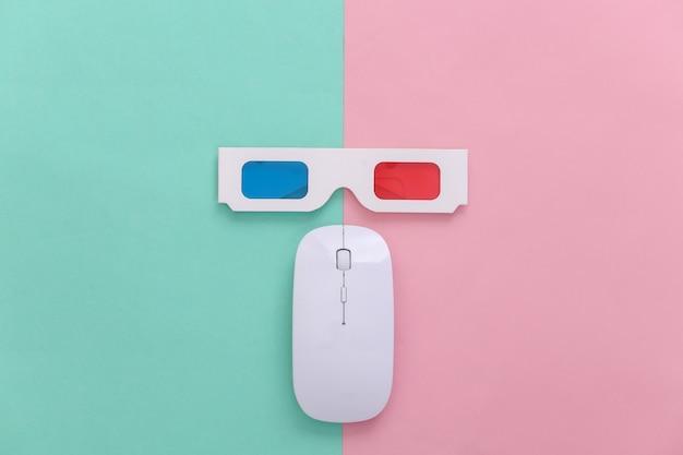 Souris pc et lunettes 3d anaglyphes sur fond pastel bleu rose. vue de dessus. minimalisme