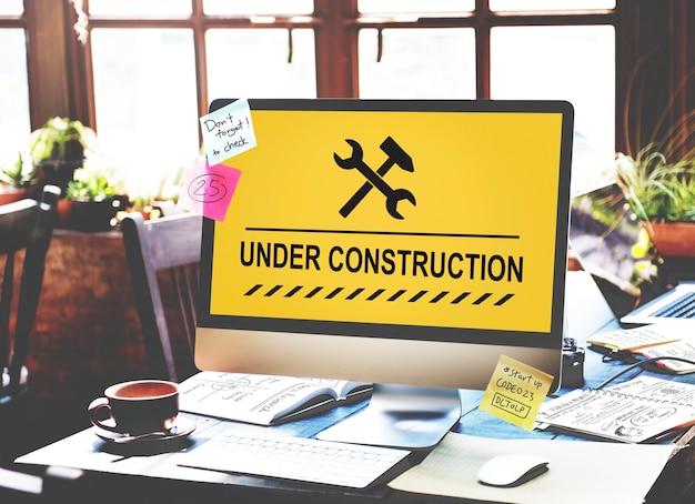 Sous Le Concept D'icône De Panneau D'avertissement De Construction Photo gratuit