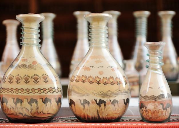 Souvenirs - bouteilles avec du sable coloré