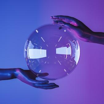 Sphère de cristal avec les mains