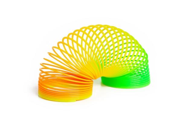 Spirale arc-en-ciel coloré en plastique jouet pour jouer isolé