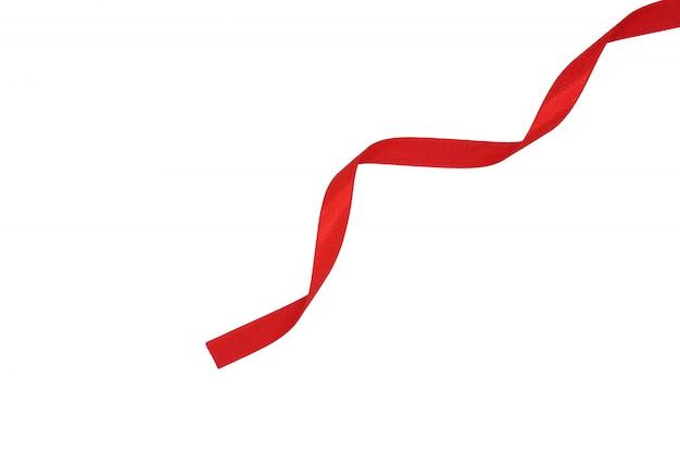Spirale de ruban de tissu rouge isolé